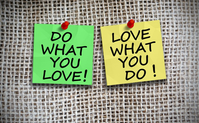 "Two Post-it notes on a board, each reading ""Do What You Love"" and ""Love What You Do"" respectively"