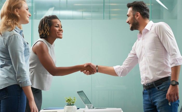 Business professionals greeting each other with a handshake during an interview