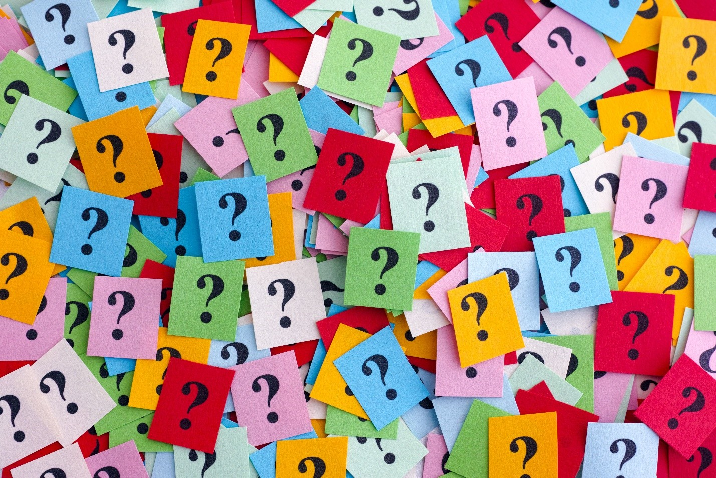 A board of colorful sticky notes with question marks