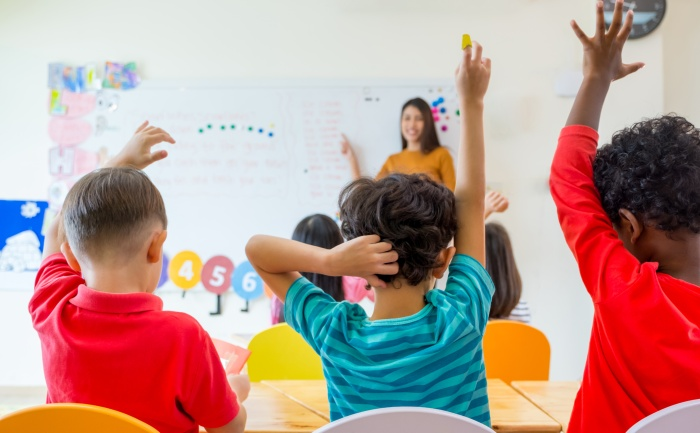Elementary school teacher and her students in the classroom | Early Childhood Education Master's Degree | UTEP Connect