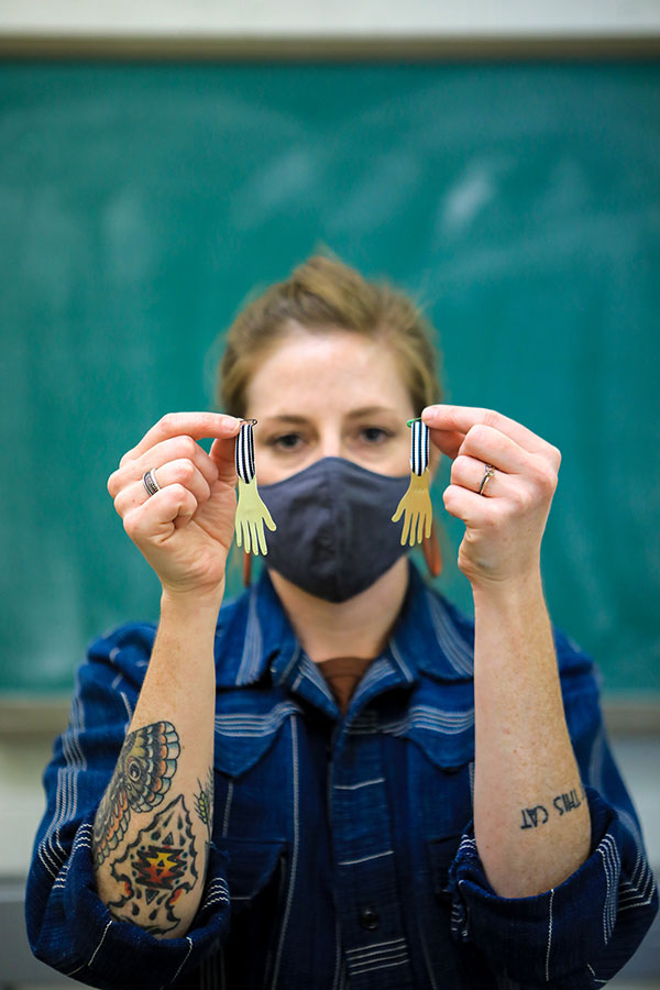 Jess Tolbert, assistant professor of art at The University of Texas at El Paso and head of the art department's jewelry and metals program, leads the region's efforts in the Hand Medal Project, a collaboration of more than 3,000 artists from 66 countries to honor health care workers who risk their lives daily in service to COVID-19 patients. Photo: JR Hernandez / UTEP Communications