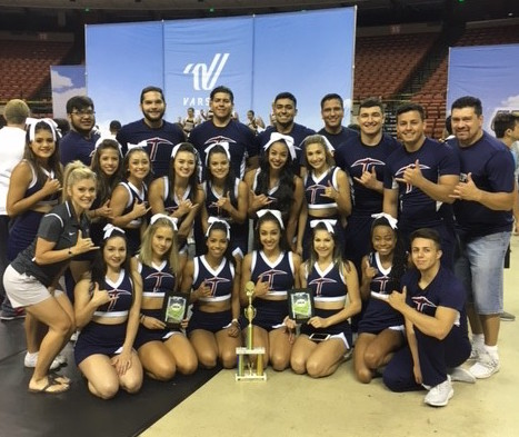 UTEP cheerleaders pose with their trophy.