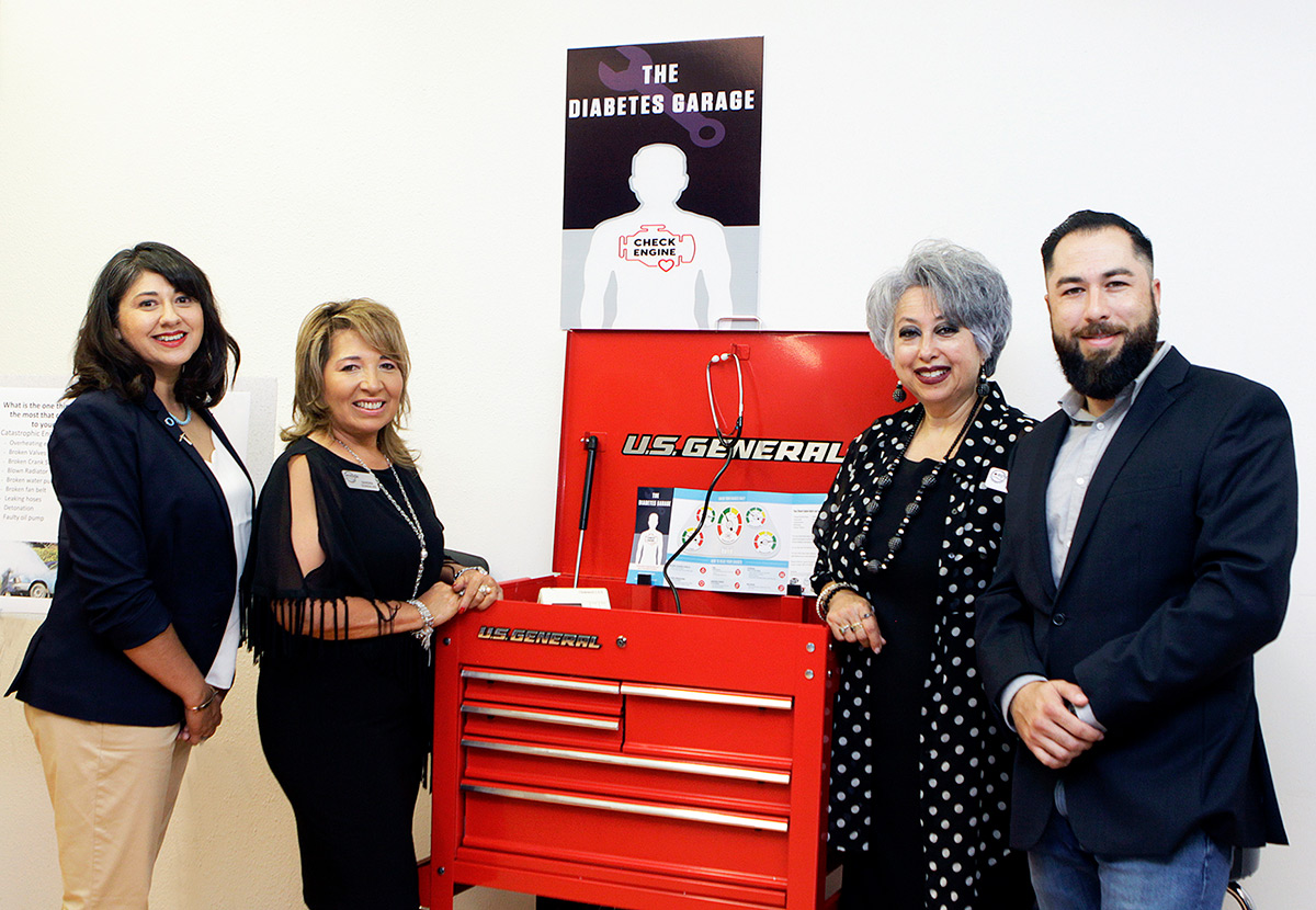 From left, UTEP Assistant Professor Jeannie Concha, Ph.D.; Sandra Gonzalez, EPDA executive director; Terry Sanchez, EPDA diabetes nurse educator; and Daniel Montes, Southwest University co-director of the Diesel and Automotive Programs, celebrate the opening of the Diabetes Garage on Aug. 2, 2018. Photo: Laura Trejo / UTEP Communications