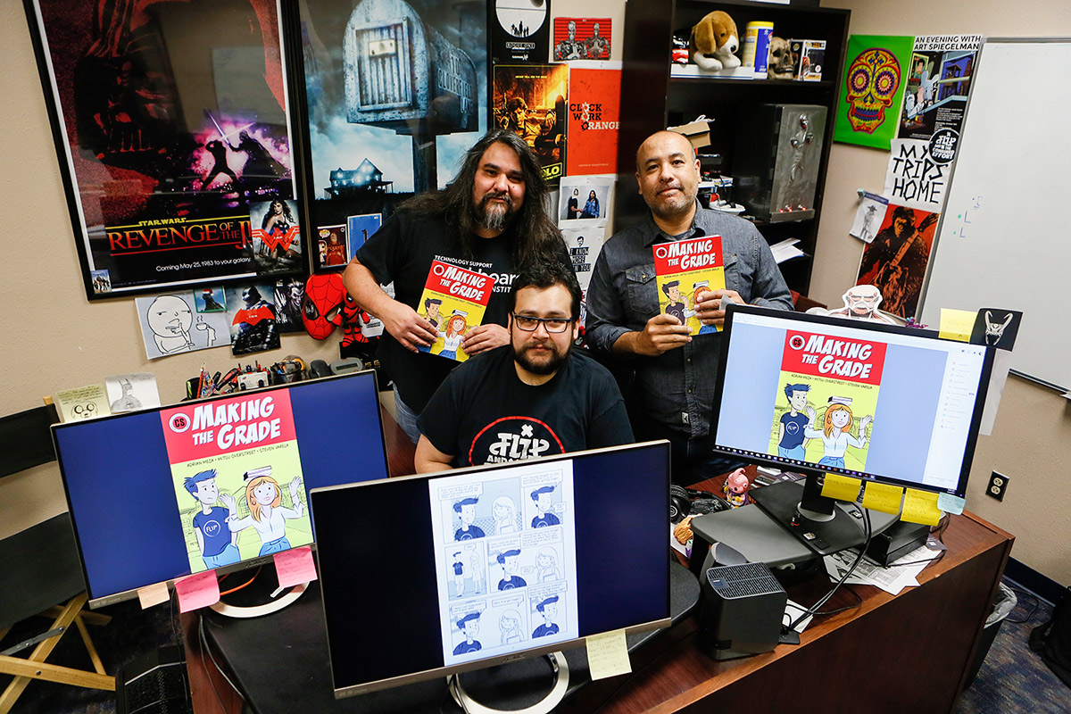 Steve Varela, associate director of Academic Technologies (AT), from left, Adrian Meza, AT instructional technologist, and Mitsu Overstreet, AT art director, created a comic book for K-12 and first-year college students that promotes academic integrity. Photo: J.R. Hernandez / UTEP Communications