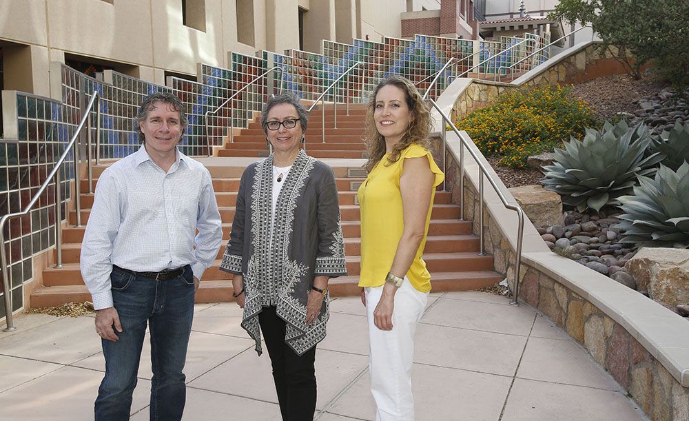 Ann Gates, Ph.D., center, professor and chair of UTEP's Department of Computer Science, was named a recipient of a National Science Foundation (NSF) grant worth $9,900,000. Gates is one of a number of collaborators — including Enrico Pontelli, Ph.D., left, dean of the College of Arts and Sciences at New Mexico State University, and Andrea Tirres, right, interdisciplinary network manager within UTEP's Office of Research and Sponsored Projects — who work with counterparts at other institutions and organizations to make up the Computing Alliance of Hispanic-Serving Institutions (CAHSI). Photo: J.R. Martinez / UTEP Communications