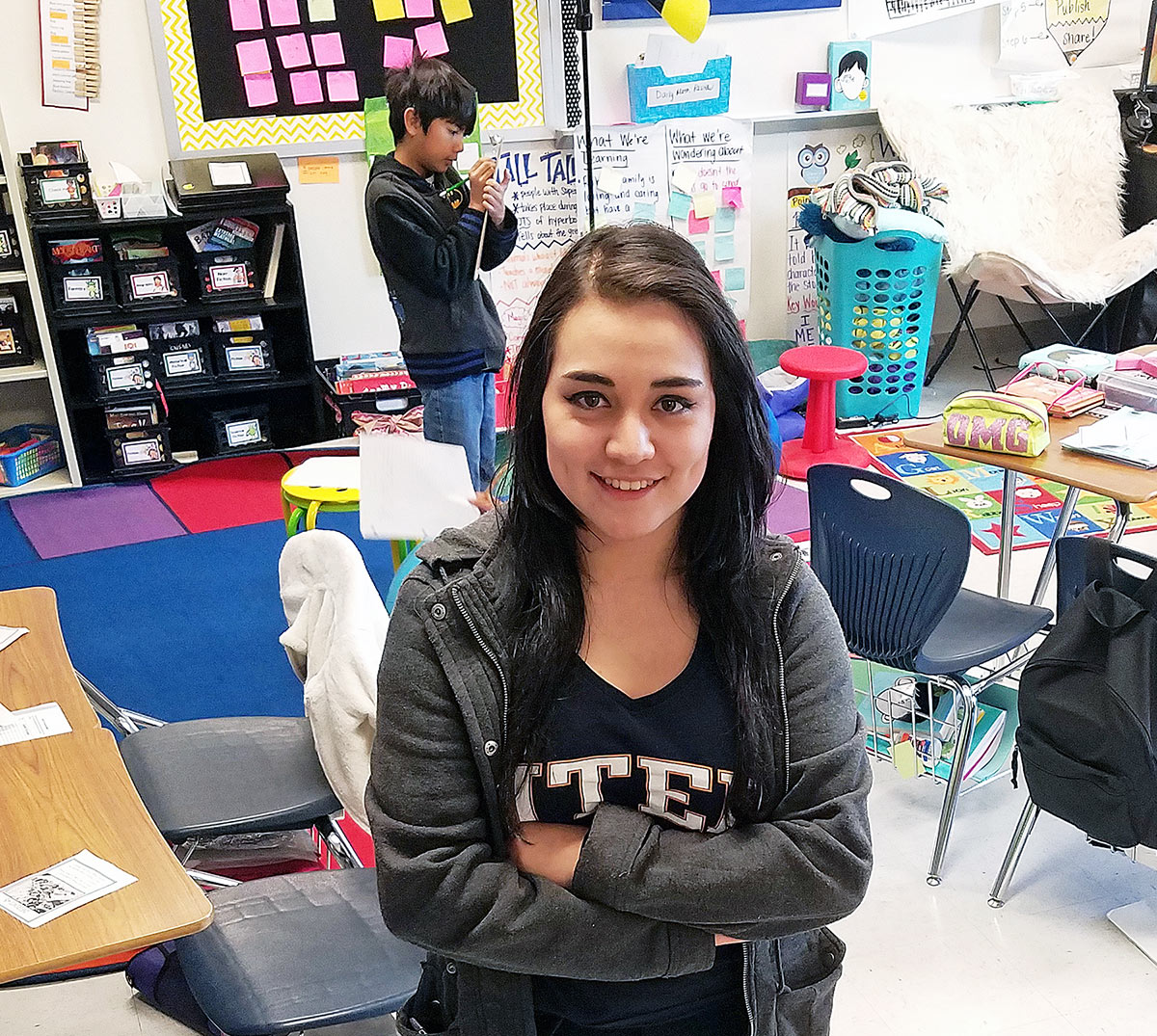 Teacher Isabel Amezaga stands in the middle of her classroom.