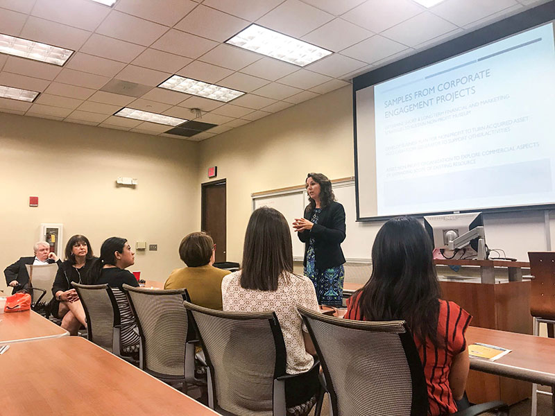 Laura Uribarri, COBA assistant dean for academic programs, talks about the Executive MBA Community Engagement Project at its launch Tuesday, July 24, 2018, at the Graduate Business Center, 201 E. Main Drive.