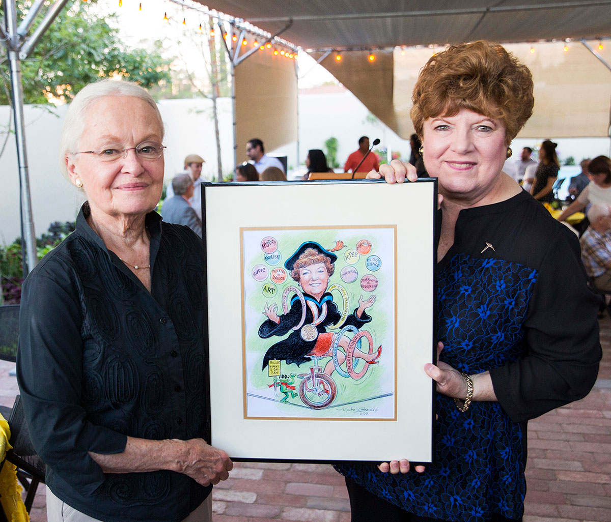 UTEP College of Liberal Arts Dean Patricia Witherspoon, Ph.D., (right) retired in August after 17 years at UTEP. Witherspoon and UTEP President Diana Natalicio (left) hold a caricature of Witherspoon by Nacho L. Garcia. Photo by UTEP News Staff