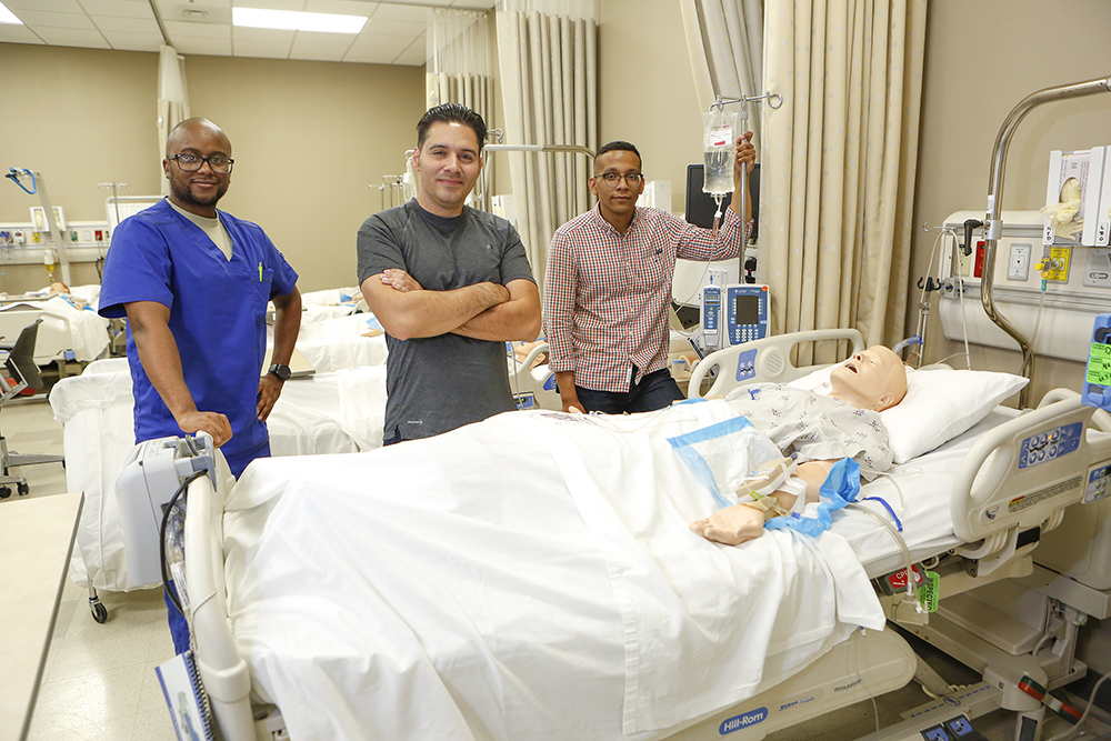 From left, Tabare Faison, Geovany Ruiz and Jeremy Alexander graduated from The University of Texas at El Paso's School of Nursing undergraduate program in August 2018. Twenty-one percent of the students enrolled in UTEP's undergraduate nursing program are male, which is higher than the national average for other nursing programs. Photo: J.R. Hernandez / UTEP Communications