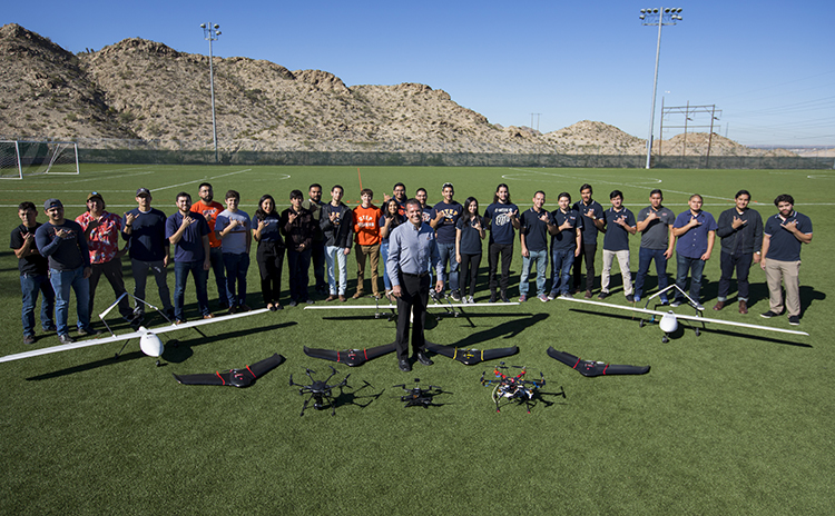 Michael McGee, Ph.D., center, stands with students from The University of Texas at El Paso's NASA MIRO Center for Space Exploration and Technology Research (cSETR). McGee, a research associate with cSETR, is leading their work in unmanned aerial systems.