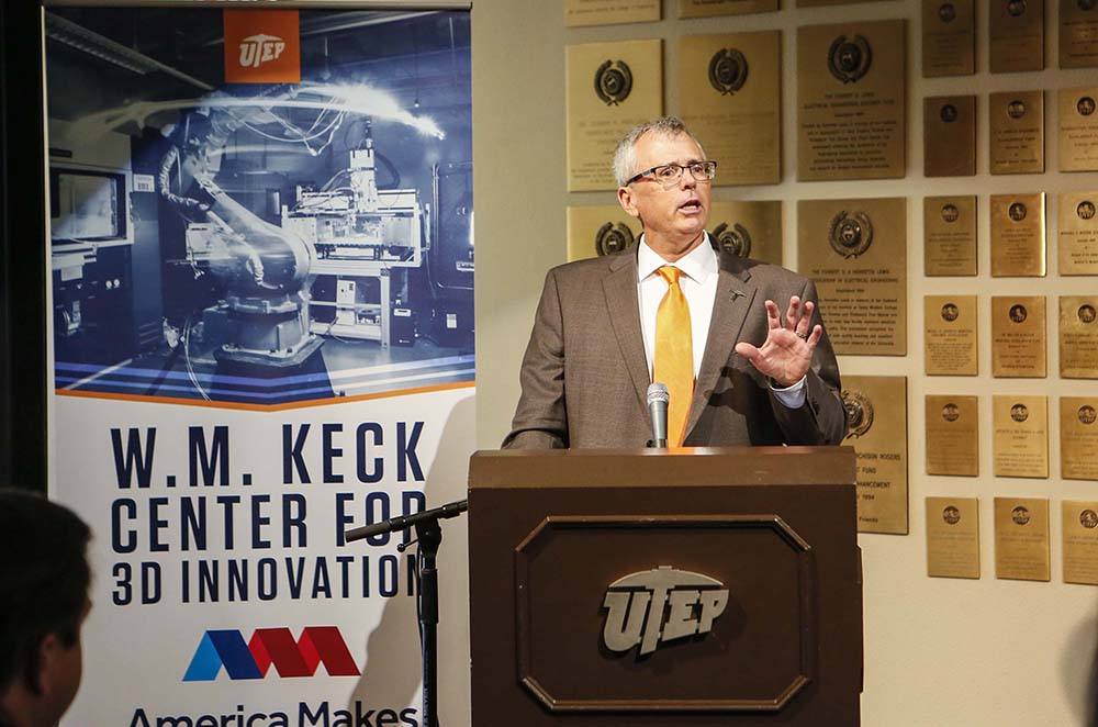 Ryan Wicker, Ph.D., founder and director of the W.M. Keck Center for 3D Innovation, speaks at a joint press conference announcing an expanded partnership with America Makes