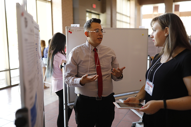 Oscar Najera, a junior psychology major, presents his research at the 2019 Campus Office of Undergraduate Research Initiatives (COURI) Summer Symposium on August 3, 2019. His project seeks to determine whether speakers of two languages can use a memorization technique known as Paired Associative Learning more successfully than monolingual people. Photo by Ivan Pierre Aguirre / UTEP Communications