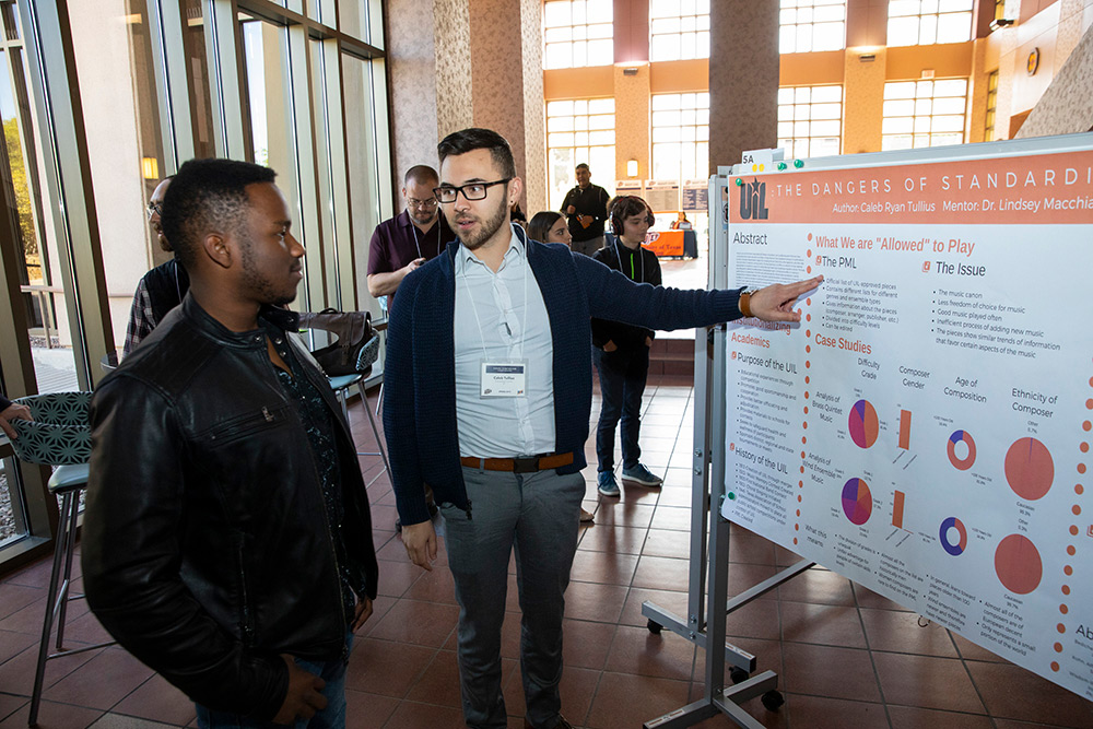 Caleb Tullius, a senior music education major, presents his research at the 2019 Campus Office of Undergraduate Research Initiatives (COURI) Spring Symposium on April 13, 2019. His project looked into the effects of the rules that govern the selection of music that can be played during musical competitions at public schools in Texas. Photo by Ivan Pierre Aguirre / UTEP Communications