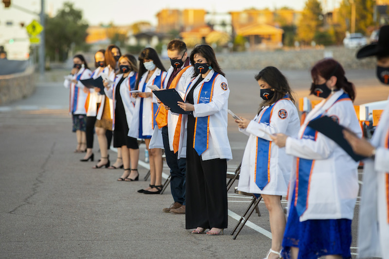 Twenty graduates from The University of Texas at El Paso's Clinical Laboratory Science (CLS) program received their white lab coats during a special drive-in ceremony at 7 p.m. Saturday, May 16, 2020, on the UTEP campus.  Photo by Ivan Pierre Aguirre / UTEP Communications