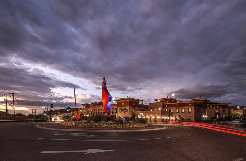 The 'Mining Minds' pickaxe sculpture at The University of Texas at El Paso's Sun Bowl-University roundabout will be illuminated in blue and orange from Wednesday evening, May 13, through Sunday evening, May 17, to commemorate UTEP's Class of 2020.