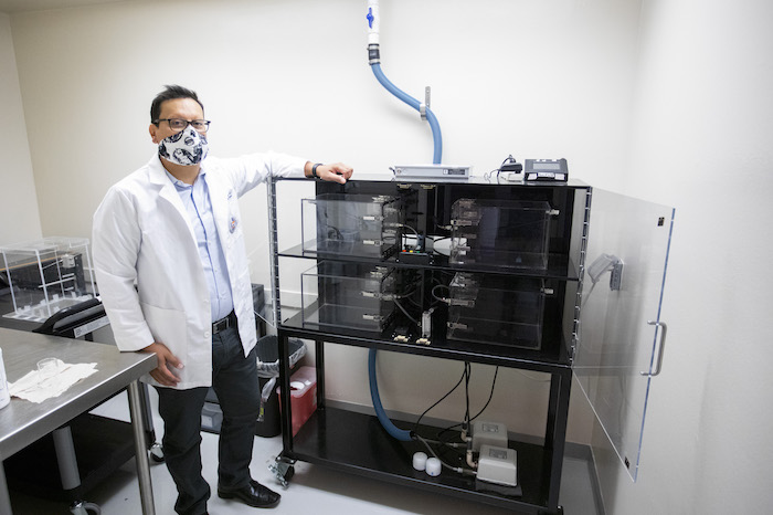 Ian Mendez, Ph.D., UTEP assistant professor of pharmacy, is using a vapor inhalation system to investigate the effects of nicotine vapor exposure on adolescent behavior. Photo: Ivan Pierre Aguirre / UTEP Communications