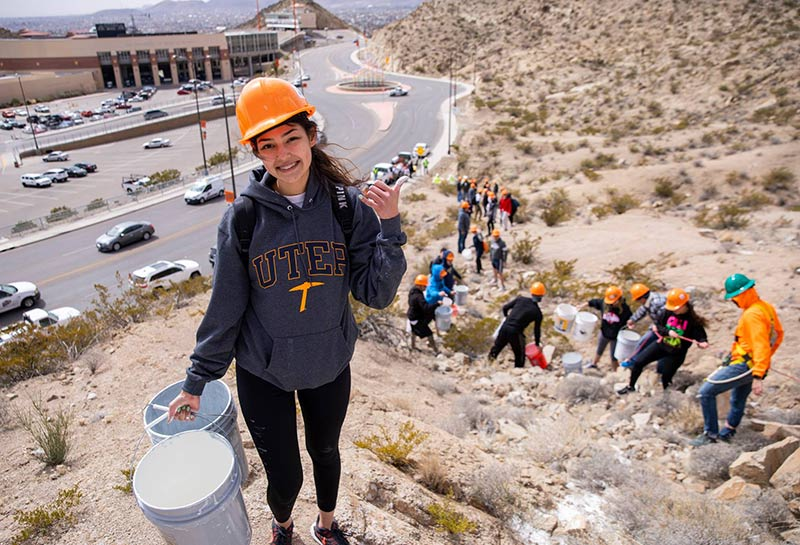 The 'Mining Minds' pickaxe sculpture at the Sun Bowl-University Roundabout will be illuminated in blue and orange Friday evening, March 13, 2020, in honor of TCM Day, The University of Texas at El Paso's longest-running tradition. Photo: JR Hernandez / UTEP Communications