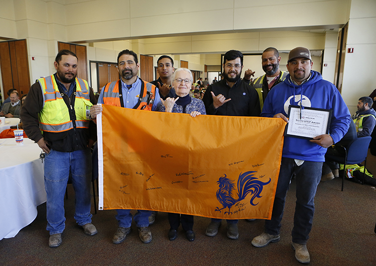 "The ""topping out"" of the Interdisciplinary Research Building was celebrated on Feb. 11, 2019, in the El Paso Natural Gas Conference Center. University leaders and construction workers who participated in the project signed an orange flag with a rooster on it that will remain on top of the building through the remainder of the project. The rooster has a special cultural significance in Bhutan, the small Himalayan kingdom that has influenced the University's architecture since 1917. Photo: JR Hernandez / UTEP Communications"